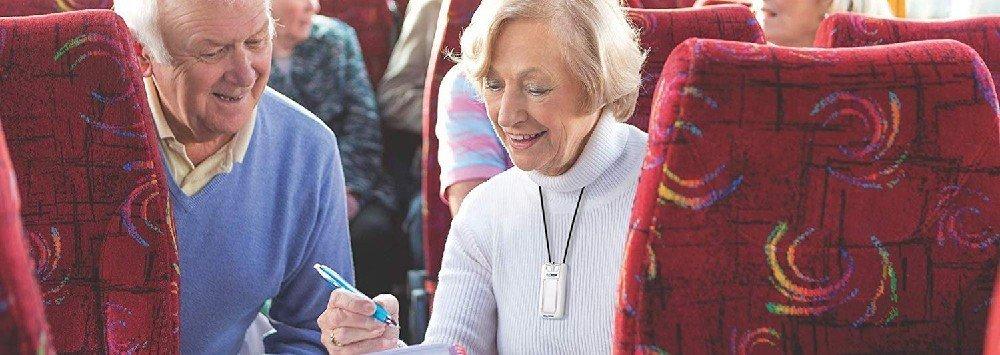 Elderly Couple Wearing Air Purifiers