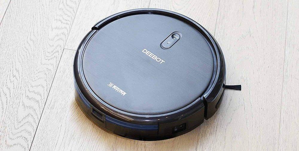 """>ECOVACS DEEBOT N79 Robotic Vacuum Cleaner Review"""" width=""""1000″ height=""""505″ class=""""aligncenter size-full wp-image-59756″ /></p> <p>For smooth navigation, this robot vacuum contains infrared sensors. The black bumper on the slate gray vacuum prevents dings and dents, and its treaded wheels are able to maneuver over 1.4-centimeter thresholds. If you have a large house, you'll appreciate the N79's Find Me feature, especially since its short height of 3.1 inches allows it to easily fit under furniture. </p> <p>You can use the remote to control the robot if you're at home. Alternatively, you can install the Ecovacs app on your Android or iPhone. Either way, the remote and the app let you schedule cleaning sessions, manually drive the robot and select auto, spot, edge or single-room mode. The app also gives you status alerts. </p> <p><img src="""