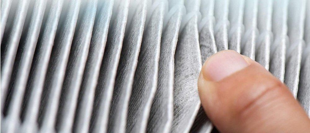 Finger through Air Purifier Filter