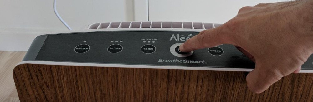 Touching the buttons on an Air Purifier